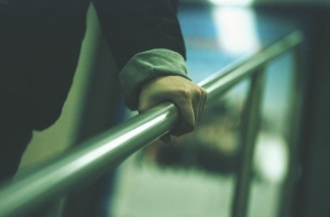 Holding onto a handrail for support
