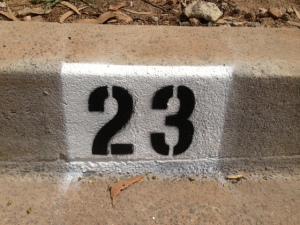 house numbers painted on the curb